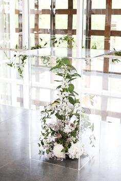 For a striking ceremony set-up, place lush, overflowing flower arrangements inside clear, Plexiglass Vintage Wedding Flowers, Floral Wedding, Wedding Stage, Wedding Ceremony, Wedding Venues, Wedding Mandap, Wedding Flower Arrangements, Floral Arrangements, Flower Stands