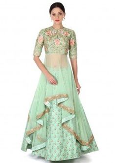 Green lehenga in silk matched with long jacket blouse in silk and net |  Credits: Kalki Fashion | Elbow length blouse embellished in Resham and Zari embroidery in flower motifs | Lehenga inspiration for Indian brides | Mehndi and sangeet outfit ideas | New lehenga styles | Bridal fashion | #WittyVows #indianbride #bride #indianwedding #lehengas #photography #bridal #couture #trousseau #portraits #trending #pretty #fashion #bridesmaids