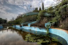 """Photographer Niki Feijen for his new book, """"Frozen"""", photographed several abandoned buildings across Europe. Capturing their haunting beauty from years of decay. Here: Jungle Splash – Slides in abandoned waterpark. (Photo by Niki Feijen) Abandoned Buildings, Abandoned Mansions, Old Buildings, Abandoned Places, Abandoned Water Parks, Abandoned Theme Parks, Abandoned Amusement Parks, Des Photos Saisissantes, Rare Photos"""