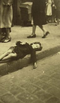 Germany, Munich, Forced labourer collapsed in the middle of the road on her way to labour camp as well-heeled germans pass her by...