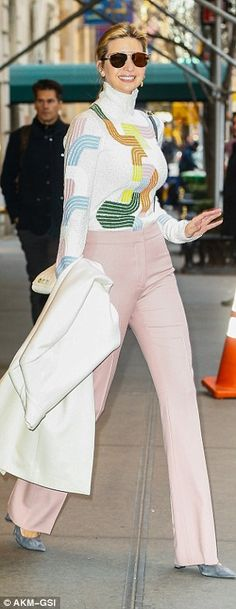 Walking billboard: Ivanka completed her outfit with a pair of sunglasses and $135 gray su...
