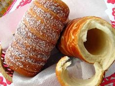 Kürtőskalács - a Hungarian pastry also known as chimney cake or stove cake. It is baked on a tapered cylindrical spit over an open fire. In the past decades, it became popular to bake it in special gas- and electric ovens. Hungarian Desserts, Hungarian Cuisine, Hungarian Recipes, Romanian Recipes, Pasta Filo, Chimney Cake, Dough Ingredients, Sweet Bakery, Romanian Food