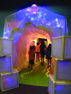Build a time travel portal using sheer fabric and fun lighting… This idea and many, many others are in the Decorating Pack & Guide, in the Bible Blast to the Past VBS kit.