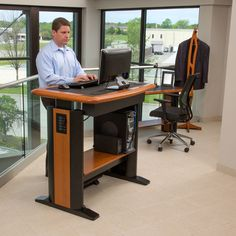 A stand-up computer desk helps to promote a healthy workspace. This is a Standing Desk from Caretta Workspace.