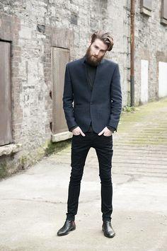 Shop this look on Lookastic:  http://lookastic.com/men/looks/black-turtleneck-navy-blazer-black-skinny-jeans-black-chelsea-boots/4974  — Black Turtleneck  — Navy Wool Blazer  — Black Skinny Jeans  — Black Leather Chelsea Boots