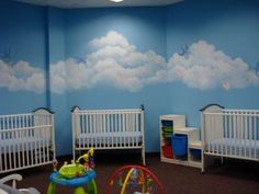 Love the blue sky and clouds with white cribs - idea from Margie Whittington Art: SAGAMORE CHURCH NURSERY MURALS