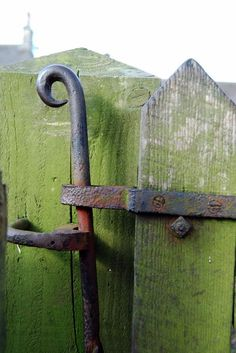 latch on green stained garden gate.........Some people look.  Some people actually see.  Look closely next time.