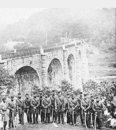 Civil war soldiers standing around near Thomas Viaduct Railroad bridge near Patapsco State Park, Ellicott City
