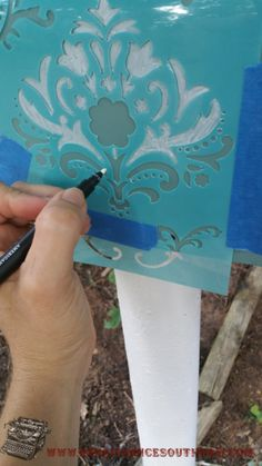 A simple stencil painted on your mailbox can add to your curb appeal.
