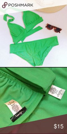 old navy swimsuit Simple perfection! This kelly green two-piece from Old Navy is the perfect accessory to your summer beach days or pool parties. Hipster bikini briefs provide good coverage while the halter top shows just enough skin. Bottoms size L, top size S. Worn just once! Old Navy Swim Bikinis