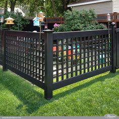 Amazing Low Maintenance Fence Idea: Black PVC Vinyl Old English Lattice Fence with New England Caps from @illusionsfence is the perfect garden fence. #garden #fence #fenceideas backyardideas