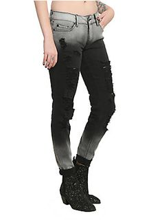 <p>Grey and black ombre skinny jeans with destroyed elements. 5-pocket styling with button and zip closure.</p><ul>	<li>98% cotton; 2% spandex</li>	<li>Wash cold; dry low</li>	<li>Imported</li>	<li><Listed in junior sizes</li></ul>