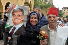 A woman holds a photo of the former slain PM Rafic Hariri, father of current PM Saad Hariri, to show her solidarity in Beirut, Lebanon. (Houssam Shbaro / Anadolu Agency) http://pow.photos/2017/lebanon-pow-16-22-november/