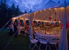 String lights illuminate an Epic canopy for a wedding -- Photo by Mark Cook