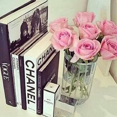 Pink roses and design books.