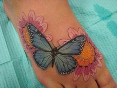 Butterfly with sunflower tattoo