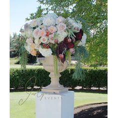 cool vancouver wedding One of the two tall lush floral arrangements complimenting the bride and groom as they exchange their vows. #justynaevents #justynafloral #vancouverevents #vancouverflorist #wedding #weddings #floralart #flowers #florist #largearrangement #ceremony #ceremonyflowers #engaged #bride #groom #romantic #roses #gardenroses #cascadingfloral #swaneset by @justynaevents  #vancouverengagement #vancouverflorist #vancouverwedding #vancouverweddingvenue #vancouverwedding