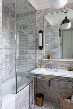 """[i]The bathroom is covered with small white tiles.[/i]  Like this? Then you'll love  [link url=""""http://www.houseandgarden.co.uk/interiors/tile-ideas""""]Miles of Tiles[/link]"""