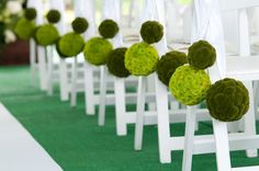 Green Pomander Ball Aisle Decor | Photography: Fandl Photography  www.tablescapesbydesign.com https://www.facebook.com/pages/Tablescapes-By-Design/129811416695