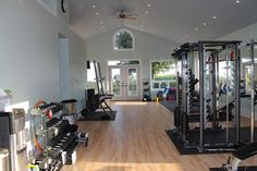 A home gym requires space and usually a little extra up-front cost than a membership to a real gym. But having a gym at home also means flexibility in your workout schedule. Home Gym Garage, Diy Home Gym, Home Gym Decor, Home Gym Design, House Design, Workout Rooms, Exercise Rooms, Small Home Gyms, Personal Gym