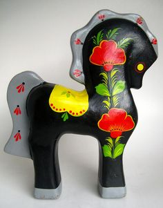 Russian. . .reminds me of Dala horses from Sweden, yet different . .I like