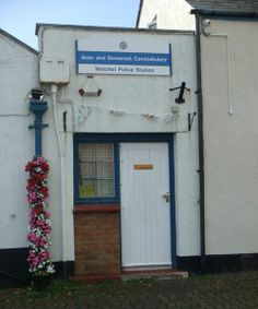 Surely the smallest police station in the UK? Somerset, loving the flowers and the name -Watchet Police Station!