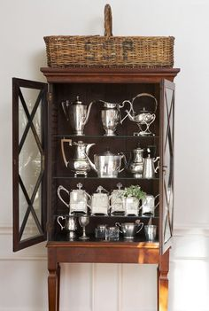 cote de texas - stylish cabinet filled with hotel silver Vintage Silver, Antique Silver, Antique Maps, Houston Houses, Silver Trays, Silver Plate, Deco Design, Displaying Collections, China Cabinet