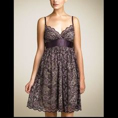 Sweet Purple Lace Babydoll dress Dark purple/grey lace dress. Knee length with scalloped hem. Adjustable spaghetti straps. Satin tie waist. Size Small. Purchased at Nordstrom. Rayon/Nylon/Poly.  Great condition. Necessary Objects Dresses