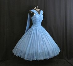 Description   An absolutely stunning 1950's dress in a gorgeous shade of sky blue chiffon ! The style typifies the 50's - oh so feminine and figure