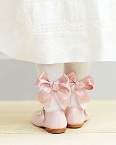 Pretty pink satin bows, and a rosy shade of nude beige for girls' shoes