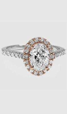 A romantic halo engagement ring in rose gold.