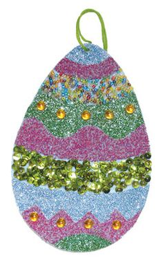 Glittery Easter Egg craft, made from craft foam, sheet adhesive decorated with sequins, glitter and beads. Copyright Pamela Maxwell 2013