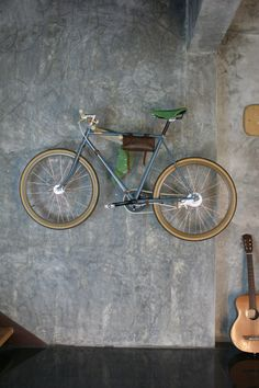 off-the-floor bike storage -- made from upcycled wood and genuine leather