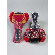 Sandals : Pair of tauranwari jutti shoes with red pom poms, camel leather, plastic tinsel and acrylic wool, Pakistan, 21st century.
