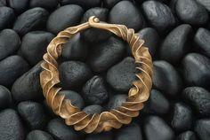 Wow! This necklace found in Danish bogland is believed to have been made in 600BC ... via Crafts Council, UK FB   ~ Photo: Sissie Brimberg/National Geographic Creative
