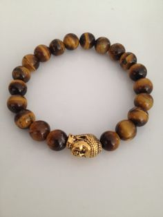 SALE Tiger Eye and Gold Buddha Head Bracelet by TheArtsyNomad, $20.00