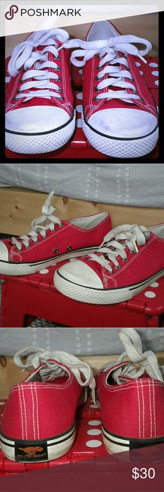 Rocket Dog 'Converse Style' Red Sneakers Women's size 7 1/2 M.  In excellent condition.  Only wore a few times.  I like these better than converse because they are wider.  But like Converse they are flat with not alot of support.  Sole in good condition...just a little dirty from wear.  Rubber on toes a little dirty too, well, because they're white!  Red cotton/canvas is very clean though.  Super cute!  Tough decision to sell but I just haven't worn them enough.  They need a new home.  Lots…