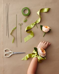 "A+wrist+corsage+is+only+as+old-fashioned+as+its+design.+To+give+yours+a+modern+look,+choose+a+flower+that+is+""big+and+elegant,""+like+a+gardenia+or+a+flat+garden+rose,+and+opting+for+a+ribbon+base+over+an+elastic+band."