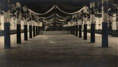"""Photograph of the McLaughlin Carriage Company's (General Motors of Canada) Christmas Party, 1918. The photograph is of """"2nd floor, Mary Street"""" and the image shows an empty hall with Christmas decorations. From the archival collection of the Oshawa Museum (A985.41.46)"""