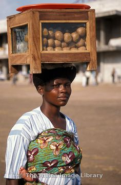 I see this all the time: Woman selling food, Ho, Volta region, Ghana