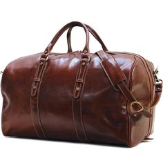 "Store your traveling essential in the stylish Floto Imports Venezia 22"" Leather Travel Duffel. It is made from polished Italian calfskin leather that enhances its strength and durability. It has a brown color with beige stripe cotton denim lining and is h"
