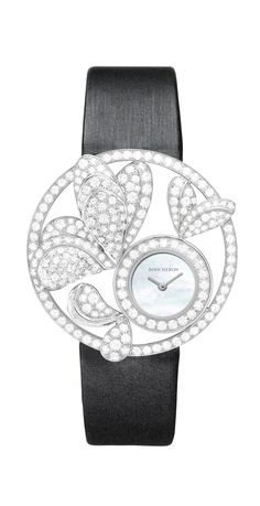 Ajourée Bouquet d'Ailes Jewelry watch Watch in white gold set with diamonds.   $74,700   Openworked and volume-sculpted wings set with diamonds on white gold 750/1000,  white mother-of-pearl dial, black satin strap. High precision quartz movement. Outer ring diameter: 38mm Water-resistant: up to 30 meters  REF.: WA017305