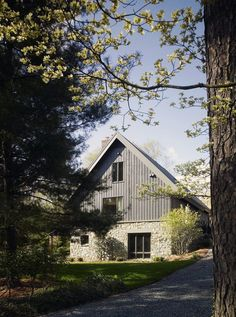 Modern farmhouse by Randall Mars Architects. Should we batten our T-11? Stucco or Stone 1st Floor?