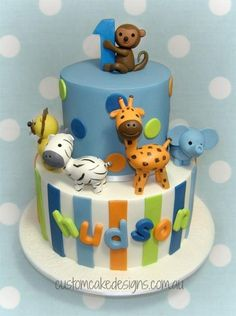 This cake was made for Hudson who is turning 1 to match his first birthday invitations. The cake is a 10 inch base with a 6 inch top tier with fondant figurines.