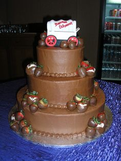 One tall grooms cake.... Look at this tuxedo strawberries !