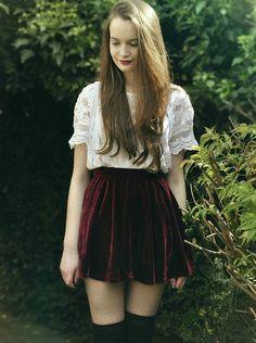 Red velvet skirt, white blouse, knee highs