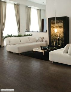 Porcelain tile - looks like hardwood floor. Easy clean up