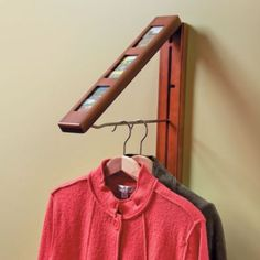 InstaHanger Picture Perfect Clothes Storage System looks like an ordinary picture frame, but swings open to disclose a handy clothes rod that can hold up to 50 lbs. Great for any room. Coat Closet Organization, Closet Storage, Home Organization, Organizing Ideas, Clothes Storage Systems, Clothing Storage, Clothes Rod, Hanging Clothes, Small Coat Closet