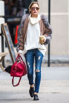 Olivia Palermo gets cozy in New York, layering several knits with her ripped skinny jeans and loafers.