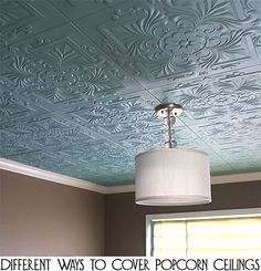 If you have dated looking popcorn ceilings in your home, you do not have to remove the popcorn for an updated look.....you could cover the popcorn ceilings instead. Here are a few different ways to cover popcorn ceilings. I like the faux tin!!